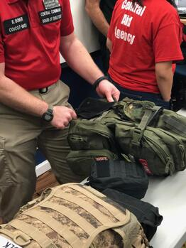 RRT and CERT Personnel attach new first aid kits to their packs at a meeting in November 2019.